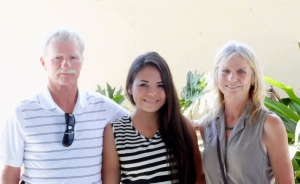 Dick & Kris McGure with university scholarship winner Kathia. Kathia is studying to be a chef.